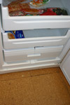 A broken drawer left behind in a dirty freezer by Karen Holliday